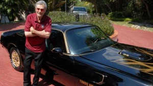 "Photo: Carlisle Auctions Burt Reynolds with his 1977 Trans Am ""tribute car."""