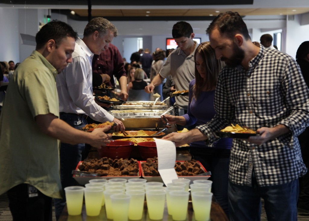 Photo: Rachael Evans Associates line up for lunch on Wednesday at Thanksgiving Tower.