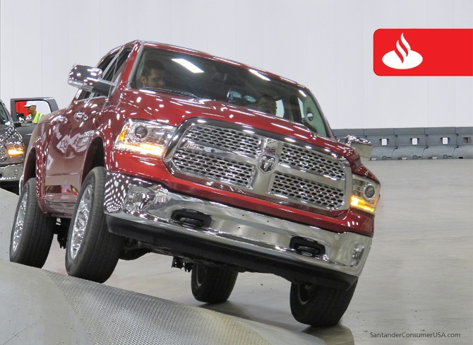 A RAM truck rolls through a ride-and-drive event at the DFW Auto Show.