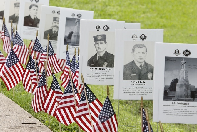 A field of flags and photos remembers some who have fallen in recent conflicts.