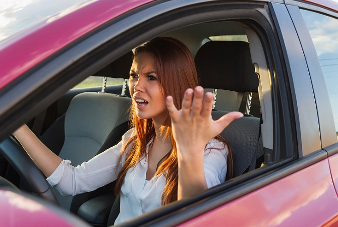 woman-in-car-with-hands-out