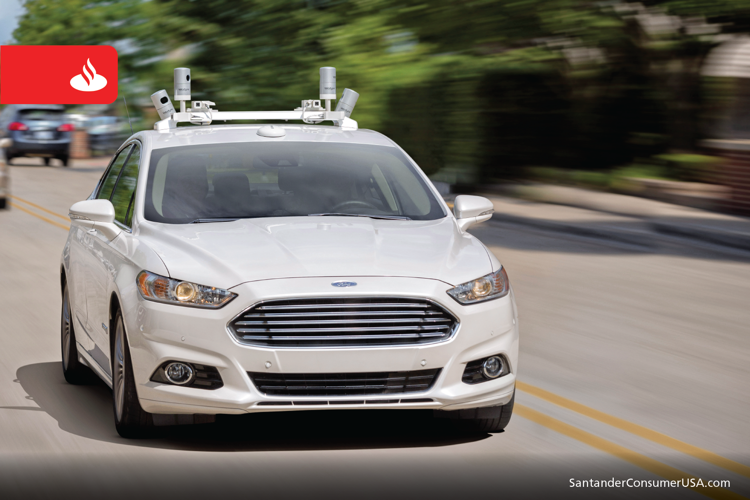 Ford Fusion Hybrid sedan autonomous vehicle on the road.