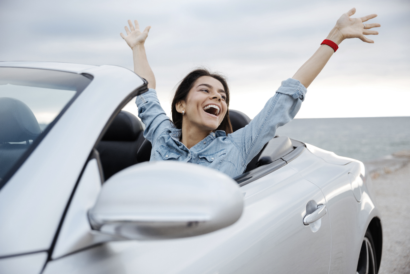 Woman Celebrating In Car