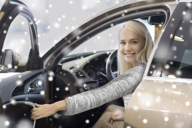 Woman in car in snowy weather