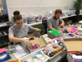 SC volunteers provide helping hands to pack M.A.G.I. boxes for kids