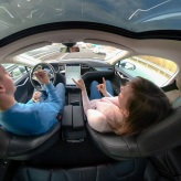 Couple in self-driving car