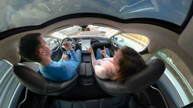 Couple in self-driving vehicle