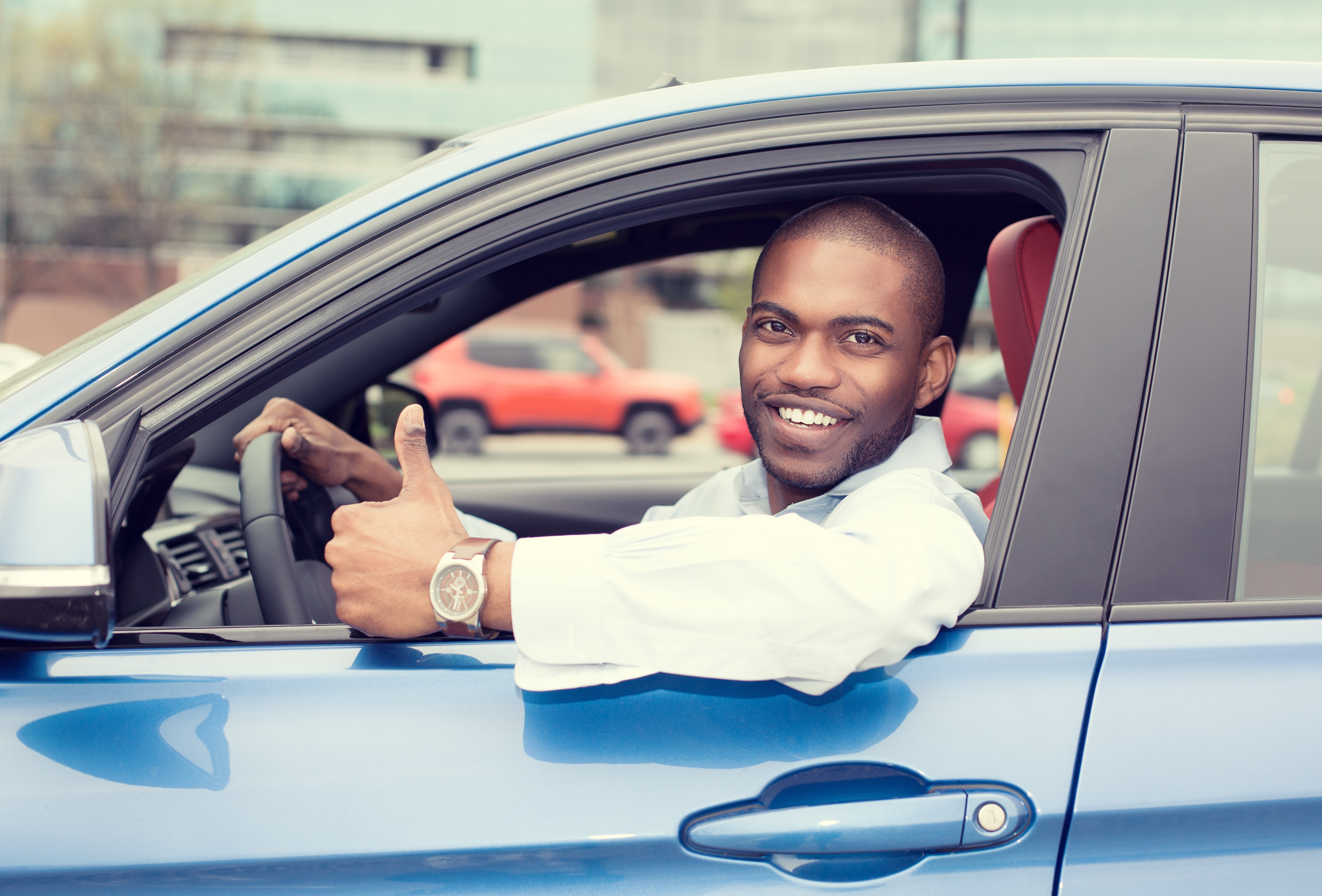 Driver giving thumbs up to smarter financing