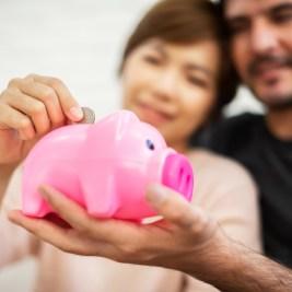 Couple saving in piggy bank