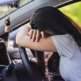 Woman slumped over steering wheel