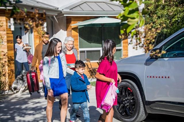 Family leaving house