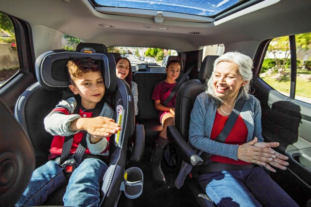 Older woman and kids in back seats