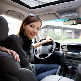 http://Woman%20sitting%20in%20new%20car
