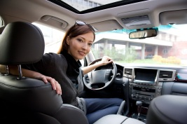 Woman sitting in new car