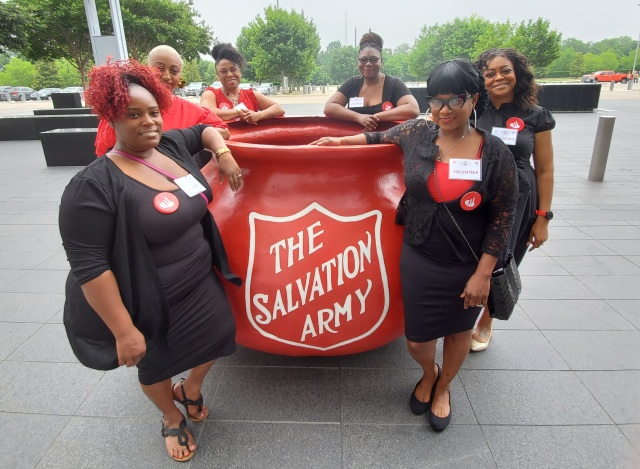 Salvation Army kettle with volunteers