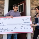 Sweepstakes winner with big check