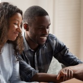 Happy couple managing credit