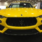 Yellow Maserati at auto show near me