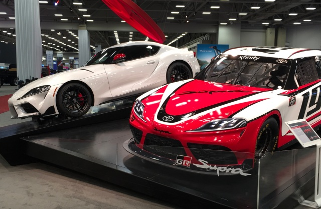 Two Toyota Supras at auto show near me