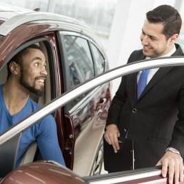 http://Car%20shopper%20sitting%20in%20vehicle%20talking%20to%20salesman