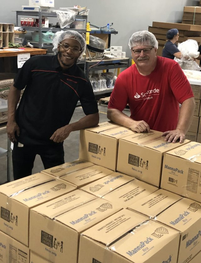 """Starving Children"" volunteers with packed food boxes"