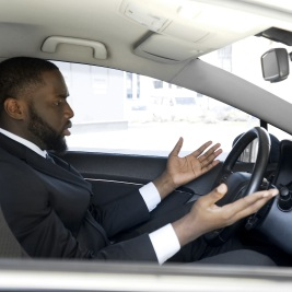 Frustrated man annoyed with bad drivers