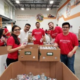 Volunteers filling boxes with water bottles