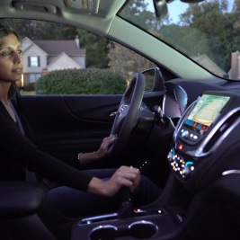 Woman using vehicle safety features