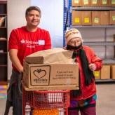 SC volunteer helping food pantry client