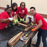 Four SC volunteers working on pallet garden