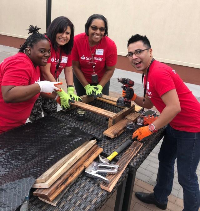 Four SC volunteers working on pallet garden