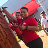 Santander volunteers painting tiny house