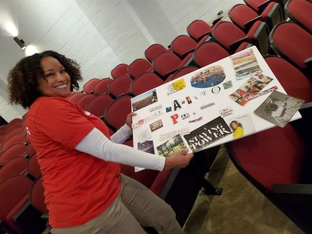 Volunteers show off vision board