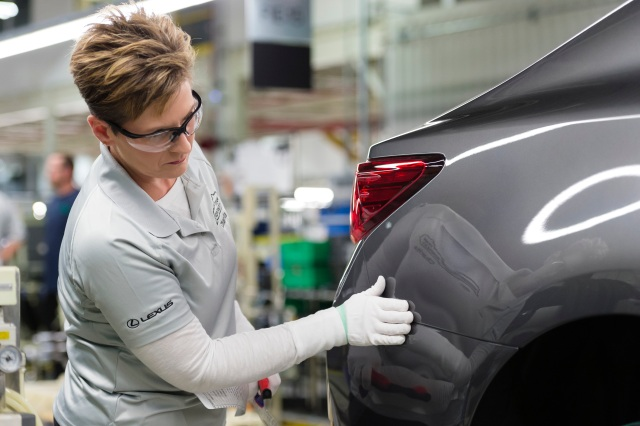 Woman inspecting Lexus ES on production line