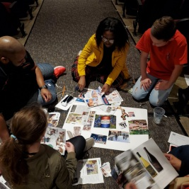 Volunteers and students work on vision boards
