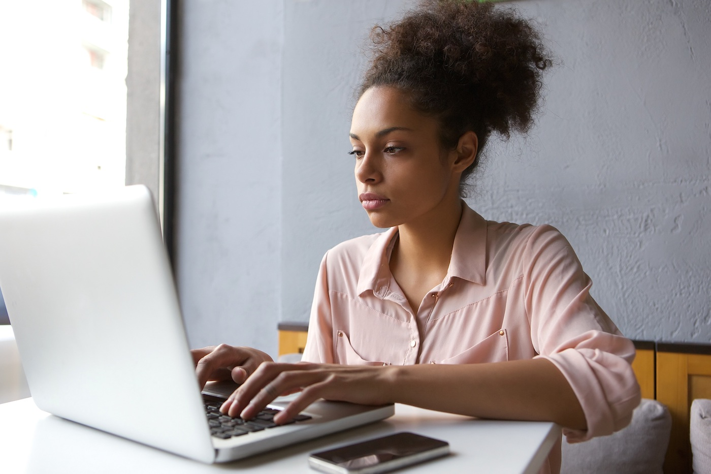Young woman using auto-finance calculator