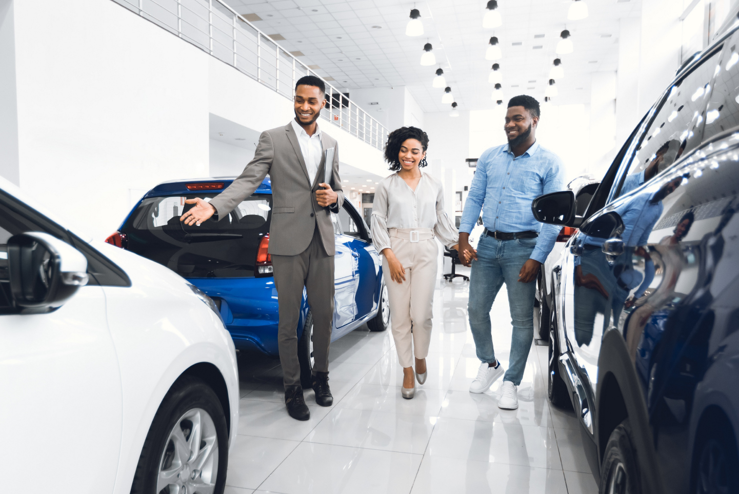 Couple with car salesman